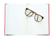 Glasses on the open book. Isolated on white (clipping path) Stock Photography