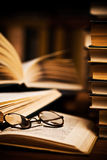Glasses on open books Royalty Free Stock Photos