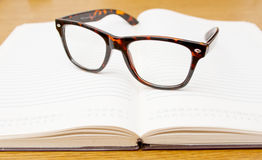 Glasses on open empty book Royalty Free Stock Photos