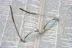 Glasses on opened book Royalty Free Stock Images