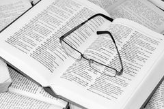 Glasses on opened dictionary Royalty Free Stock Photo