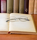 Glasses and opened old book Royalty Free Stock Photo