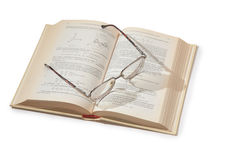 Glasses on opening textbook. On white Stock Photos