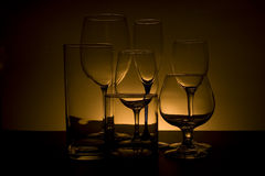 Glasses with orange back light. Arrangement of beverage glasses with orange back light Royalty Free Stock Photography