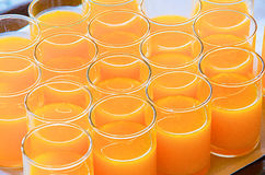 Glasses of orange juice stick together ready to serve Stock Image