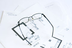 Glasses over blueprints Royalty Free Stock Image