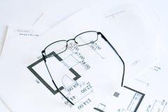 Glasses over blueprints. Image of eyeglasses over blueprints royalty free stock image