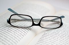 Glasses over a book Stock Photography