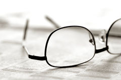 Glasses over Newspaper Classified Section Stock Photography