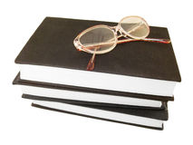 Glasses over some books. Isolated Stock Photos
