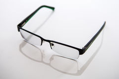 Glasses. Pair of black / green modern glasses with reflection stock photography