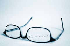 Glasses and paper with  E=mc2 Stock Photography