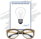 Glasses and paper sheet with light bulb. Concept royalty free stock photography