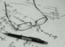 Glasses on paper sheets with equations Stock Image