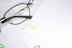 Glasses and papers Stock Image