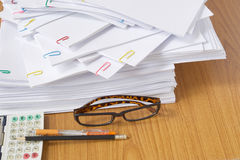 Glasses and paperwork and calculator with pen and pencil Royalty Free Stock Image