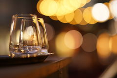 Glasses on patio at night Stock Photography