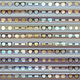 Glasses pattern on strikes background Stock Image