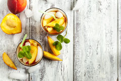 Glasses of Peach Iced Tea. Stock Photos