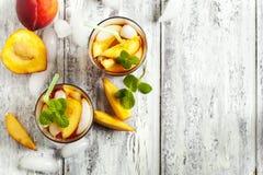 Glasses of Peach Iced Tea. Stock Photos