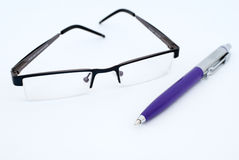 Glasses and pen Stock Photography