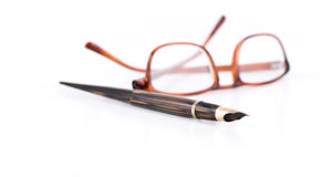 Glasses and pen. Glasses and pen on the white background Stock Photo