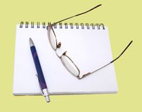 Glasses and pen Royalty Free Stock Images