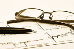 Glasses and pen on chart Stock Photography