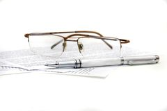 Glasses, pen and documents Stock Photography