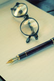 Glasses and pen Royalty Free Stock Photo