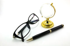 Glasses and pen. Glasses, Globe Glass tablet and pen are isolated on a white background Royalty Free Stock Photo