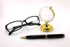 Glasses and pen. Glasses, Globe Glass tablet and pen are isolated on a white background Stock Photos