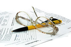 Glasses and pen of isolated. Stock Image