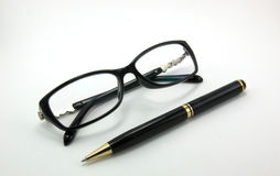 Glasses and pen. Are isolated on a white background Stock Photo