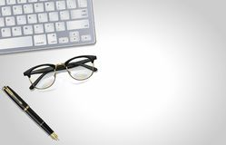 Glasses, pen, laptop - office tools on light gray background. Illustration. View from top. Glasses, pen, laptop - office tools on light gray background royalty free stock photography