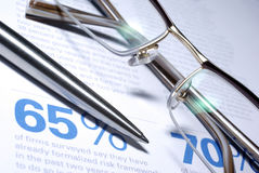 Glasses and pen macro closeup. Business Concept Stock Photos