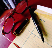 Glasses pen and notebook b Stock Image
