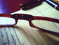 Glasses pen and notebook Royalty Free Stock Photography