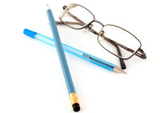 Glasses, pen and pencil-the symbols of the past Royalty Free Stock Image