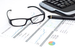 Glasses and pen on a printed web analytics report Stock Image