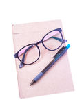 Glasses, pen, put on brown paper isolated Royalty Free Stock Images