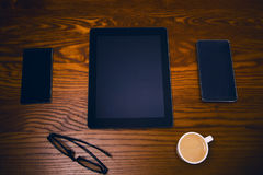 Glasses with pen and tablet on a wooden natural table. Home office. Concept of work in a office and accessories. Glasses with pen and tablet on a wooden natural royalty free stock photo
