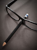 Glasses and pencil Stock Photos