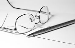 Glasses, pencil and graph. Of financial growth Stock Photo