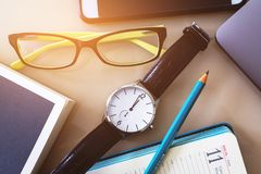 Glasses and a pencil on a notebook, a diary. Free space. Education. Business. The concept of the office. Making a plan for the day stock photo