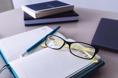 Glasses and a pencil are on the notebook. Free space. Education. Business royalty free stock photography
