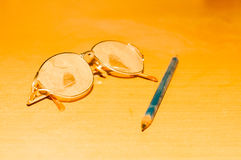 Glasses and pencil Royalty Free Stock Images