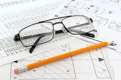 Glasses,  pencil and paper workers Royalty Free Stock Images