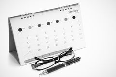 Glasses, pens, calendars. Isolated on white stock images