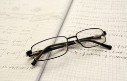 Glasses and physics Royalty Free Stock Images
